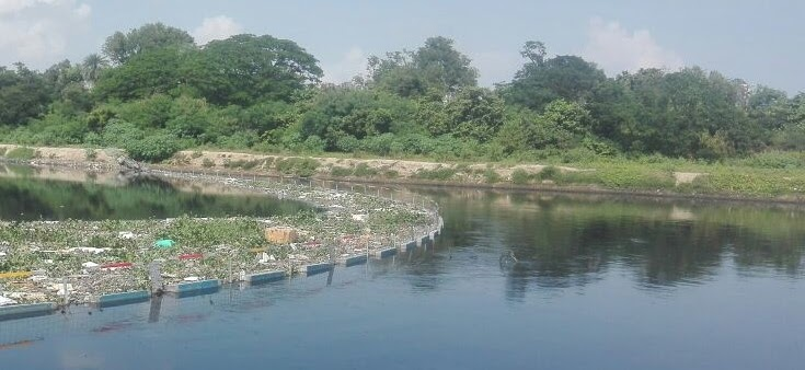 Floating trash barrier for river and lake cleanup